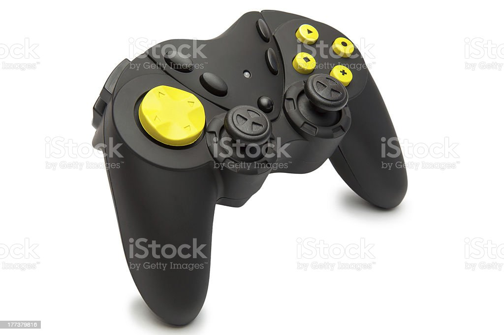 Black game controller with yellow buttons. stock photo