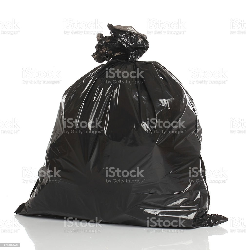 Black garbage bag isolated over white bacground stock photo
