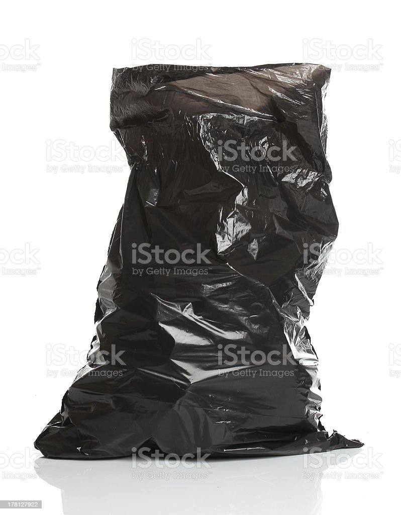 Black garbage bag isolated over white bacground royalty-free stock photo