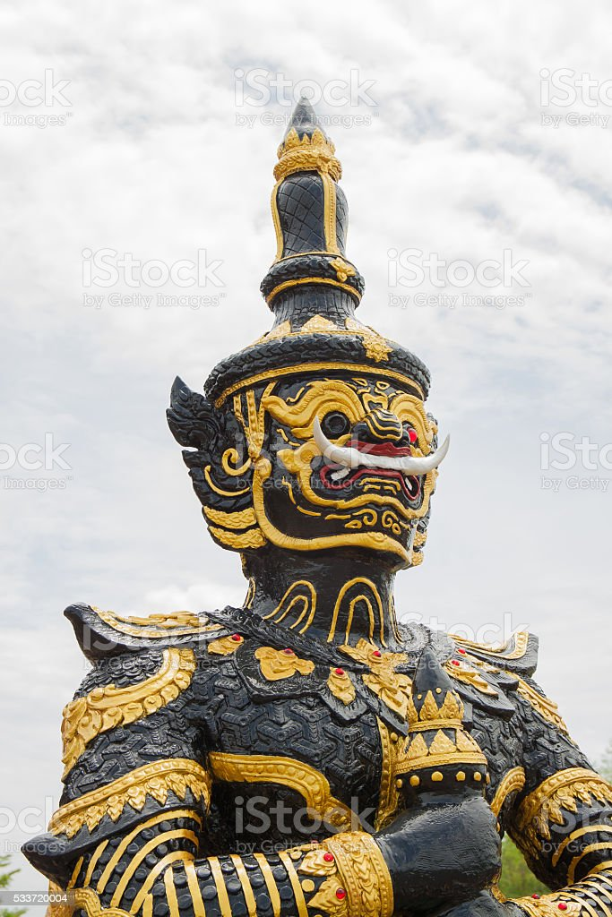 Black giant statue in thai temple royalty-free stock photo