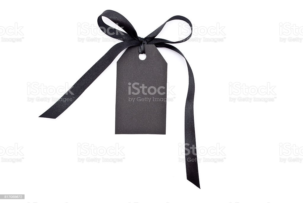 Black gift tag tied with a bow stock photo