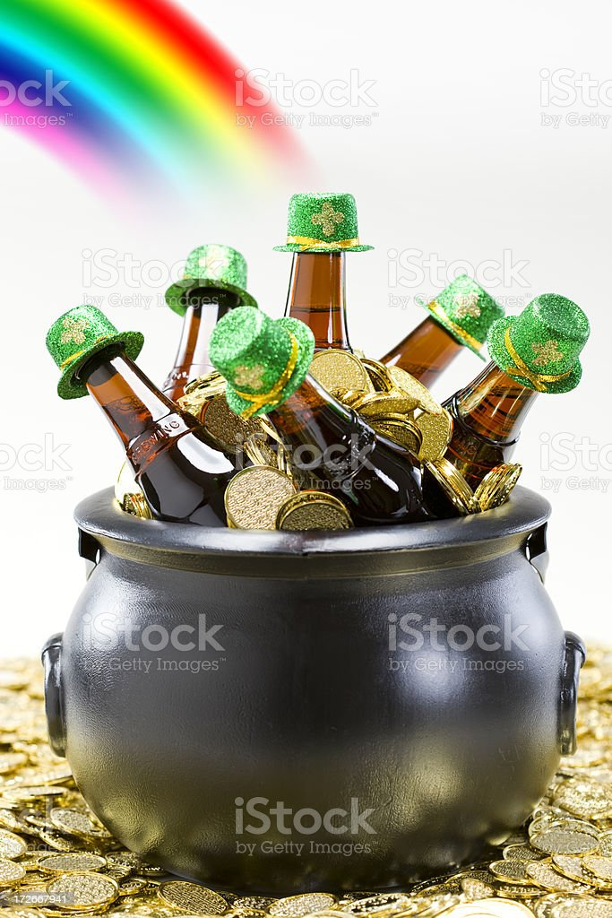 Black Gold Pot with St Patricks Beer Bottles and Rainbow stock photo