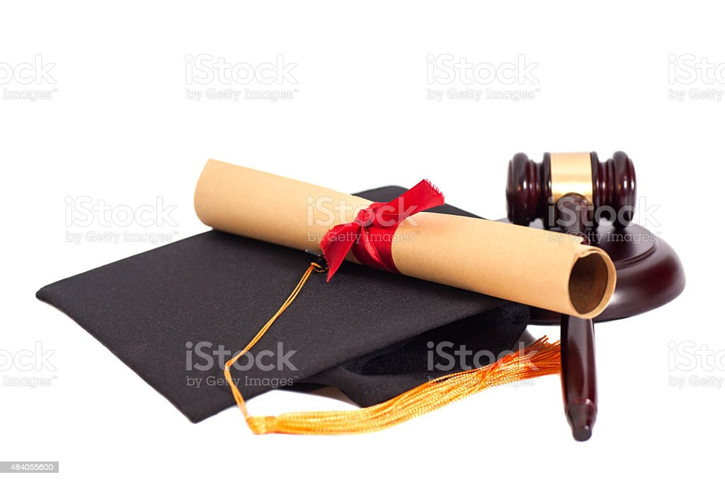 Black Graduation Hat with Diploma and Gavel stock photo