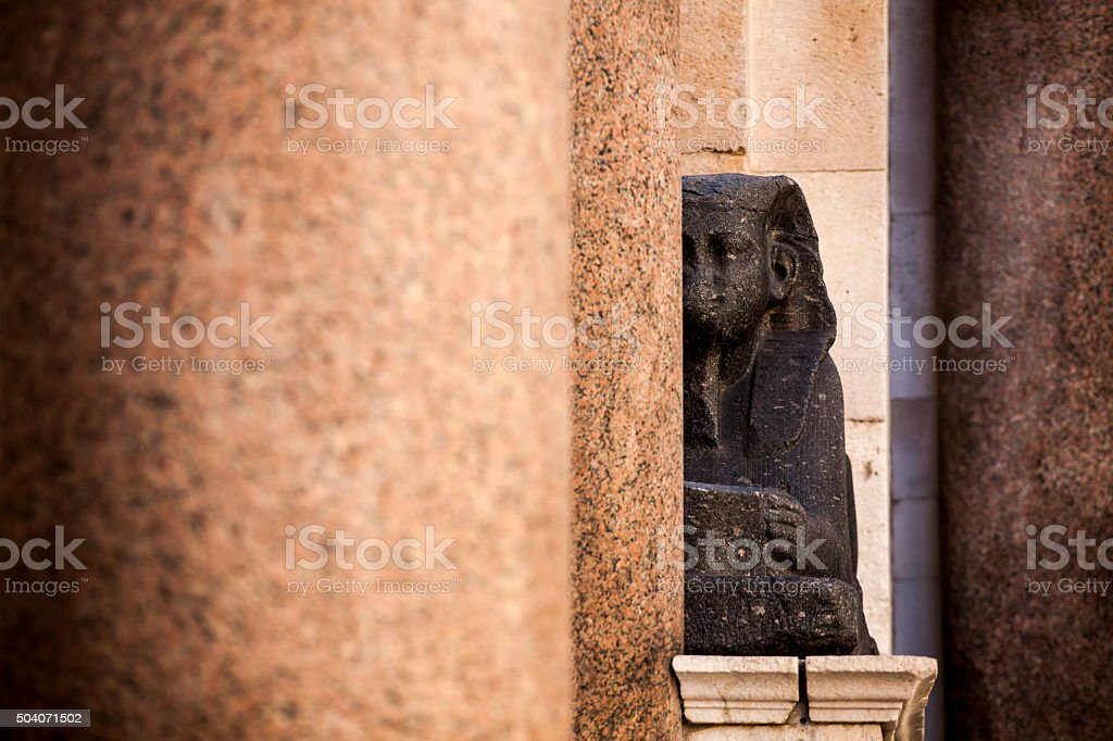 Black granite Egyptian Sphinx statue on Peristil in Split stock photo