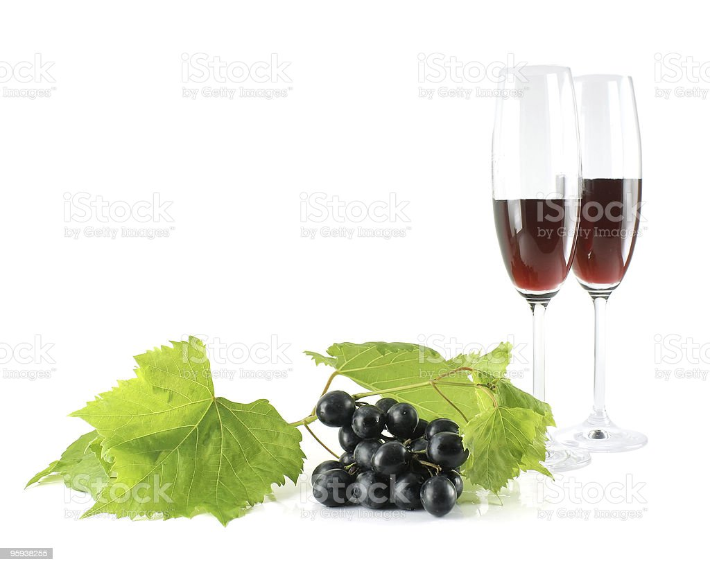 Black grapes and tall wine glasses isolated royalty-free stock photo