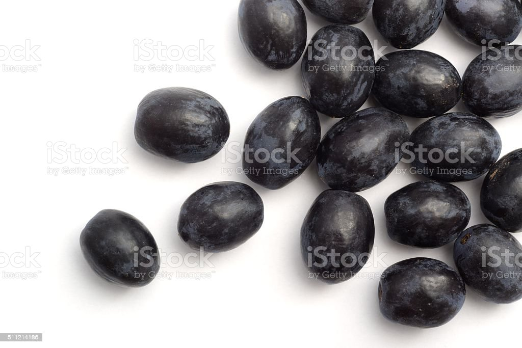 Black grapes scattered stock photo