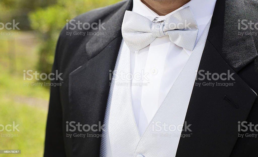 Black groom's wedding tuxedo stock photo