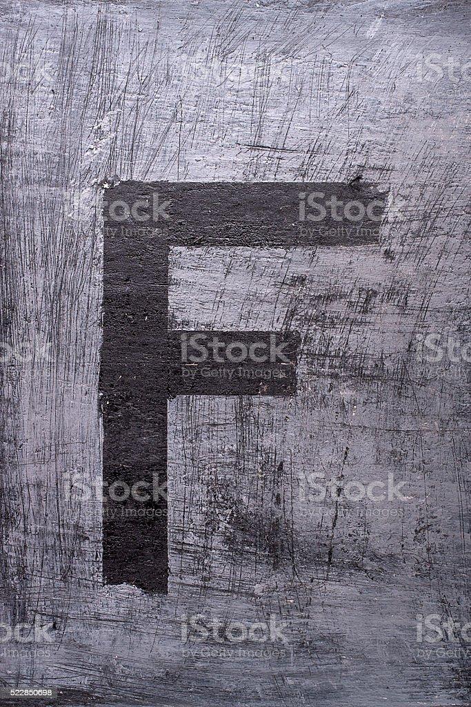 Black grunge alphabet. Letter F stock photo