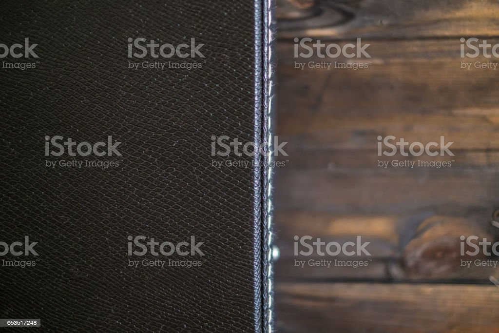 Black guitar case with wooden background stock photo