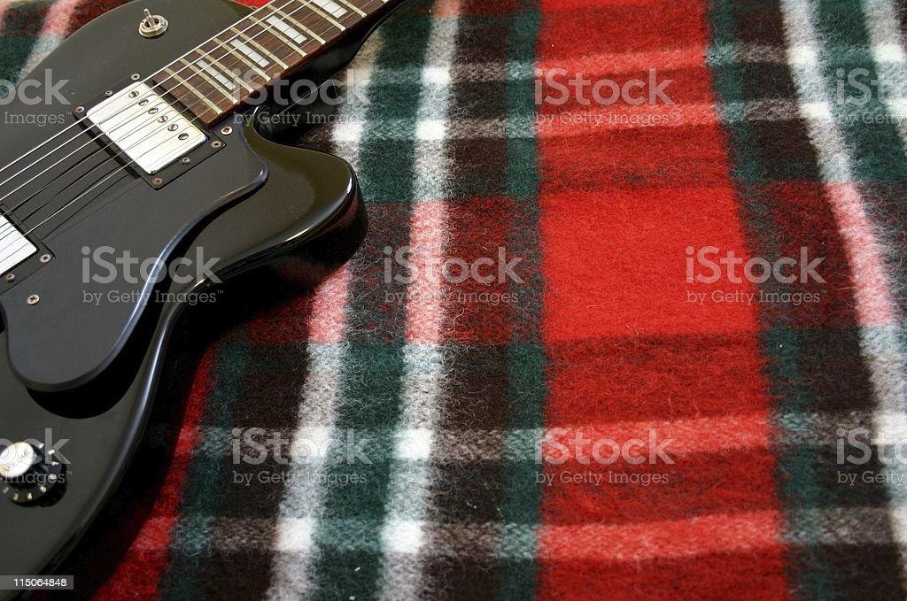 black guitar on Plaid Festive stock photo