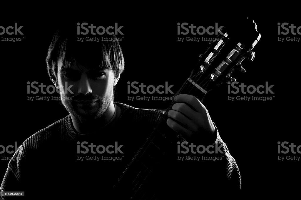 black guitarist silhouette stock photo