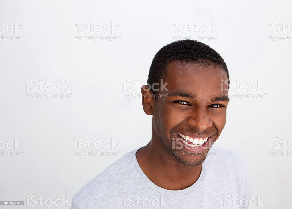 Black guy laughing against white background stock photo