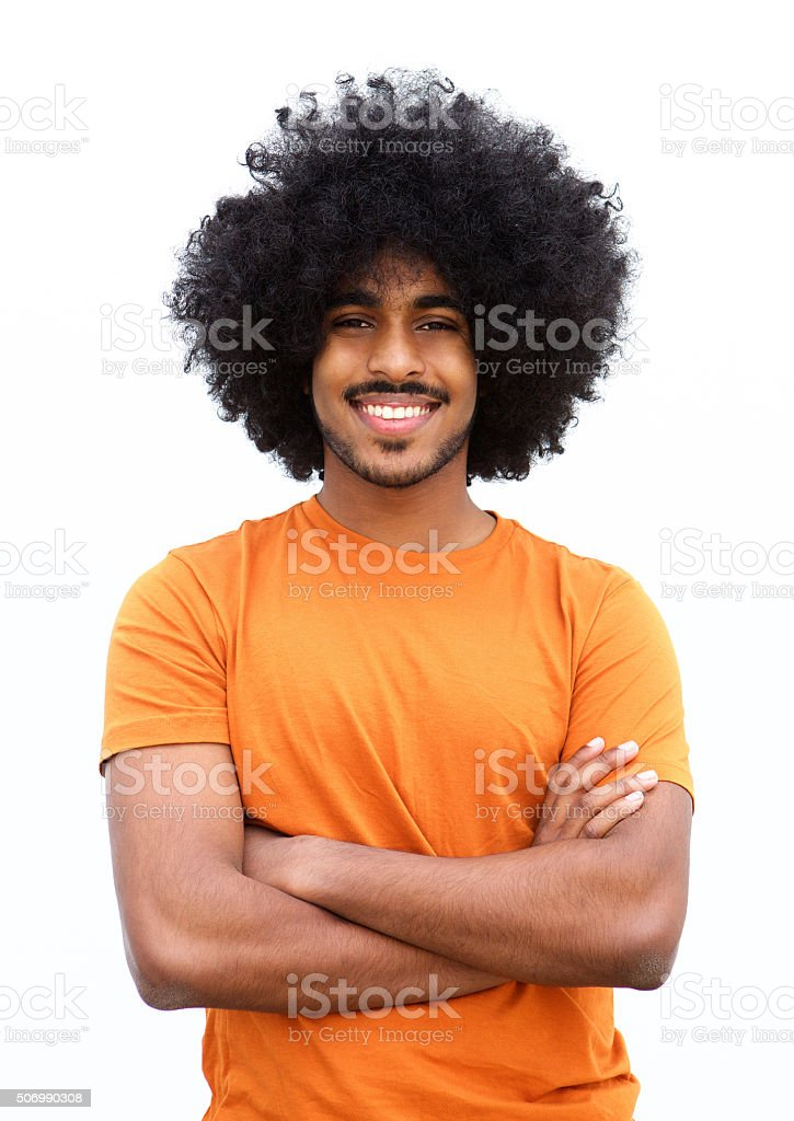 Black guy smiling with arms crossed against white background stock photo