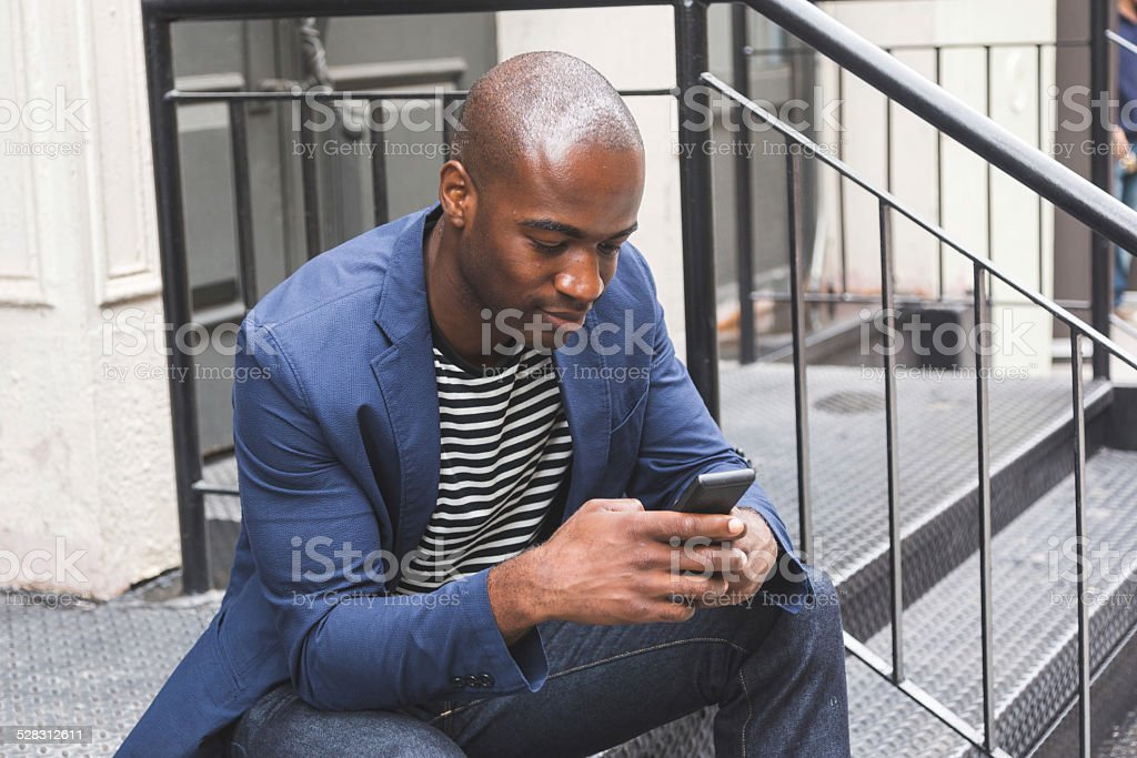 Black Guy Using Smart Phone stock photo
