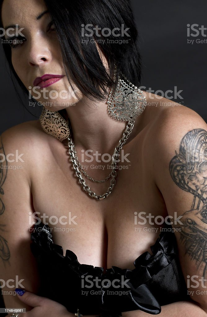 Black Hair Tattoo Female Pose  With Cleavage Large Breasts royalty-free stock photo
