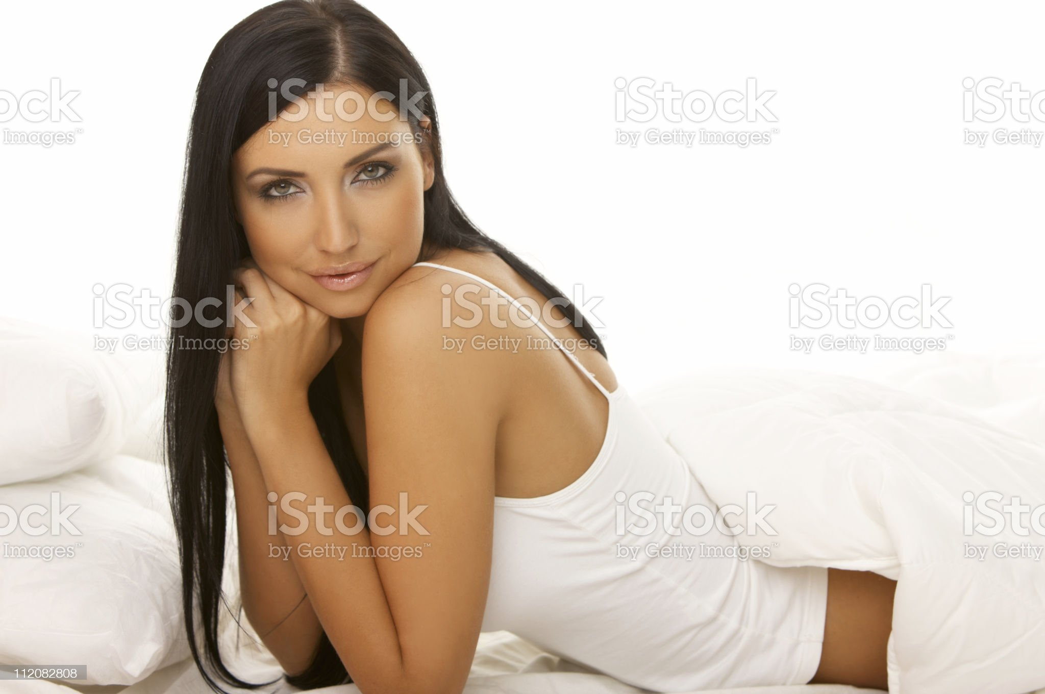 Black haired Beauty in Bed royalty-free stock photo