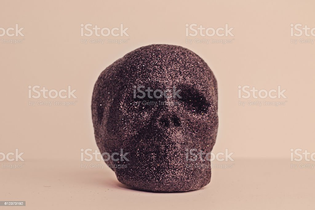 Black Halloween Glitter Skull on Pink Background stock photo