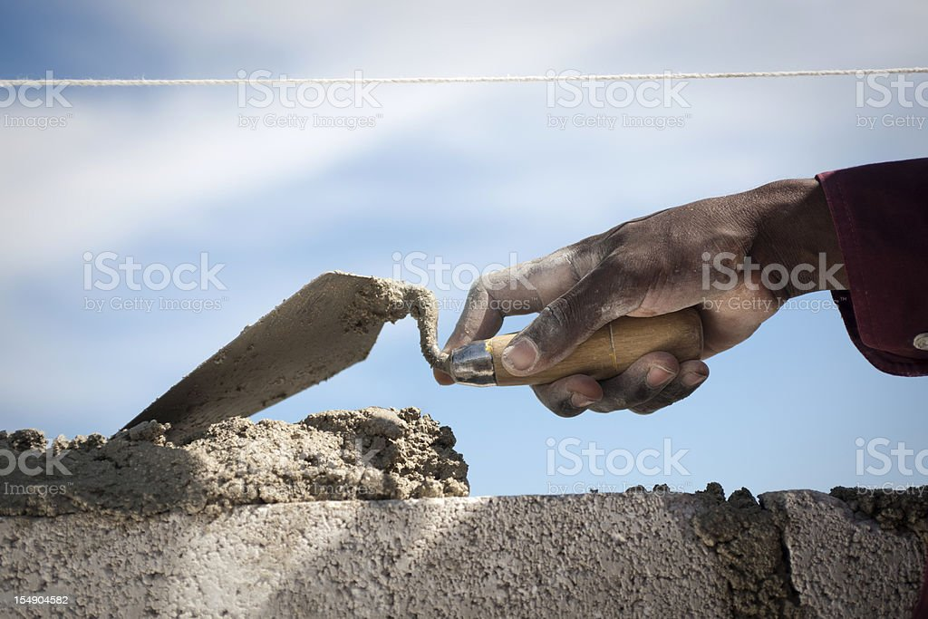 Black hand with trowel stock photo