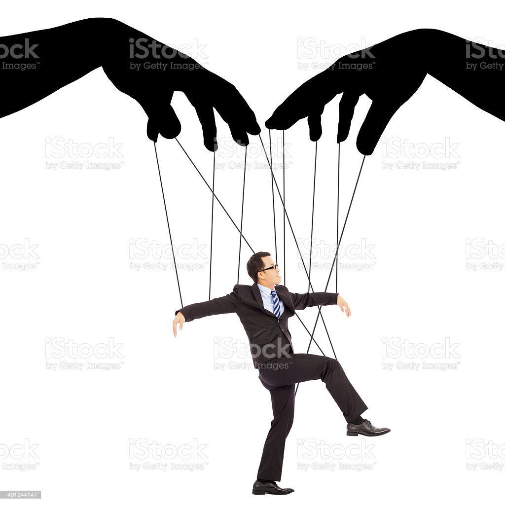 black hands shadow control a businessman action stock photo