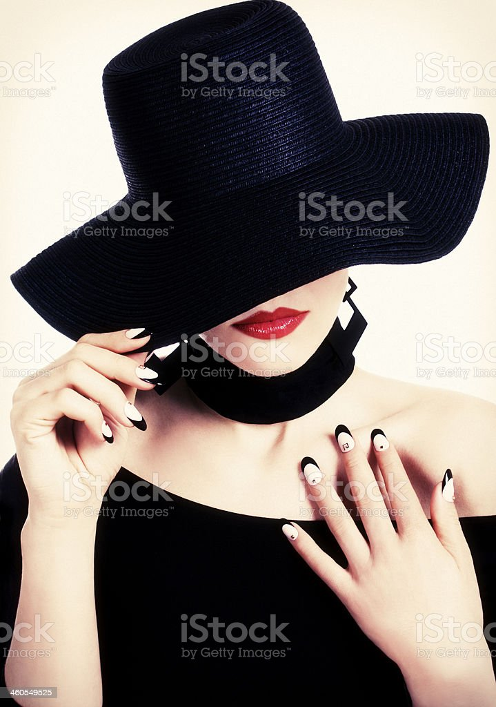 Black hat, red lips and nailart stock photo