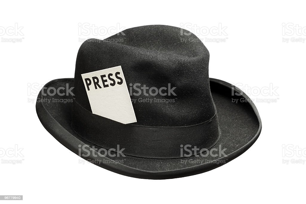 A black hat with a press sticker stock photo