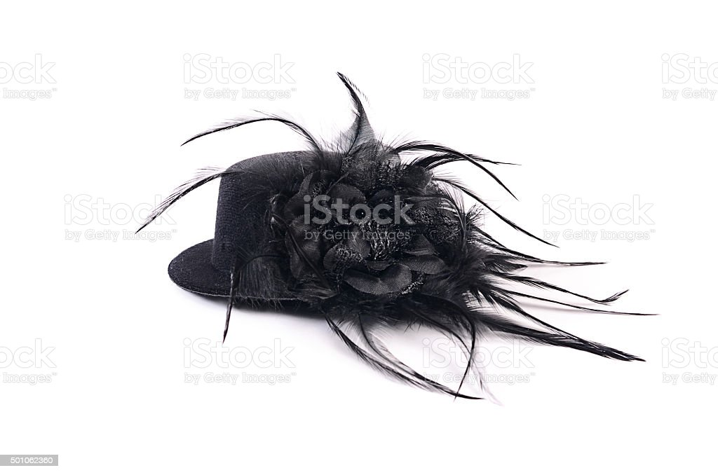 Black hat with feathers isolated on white background stock photo