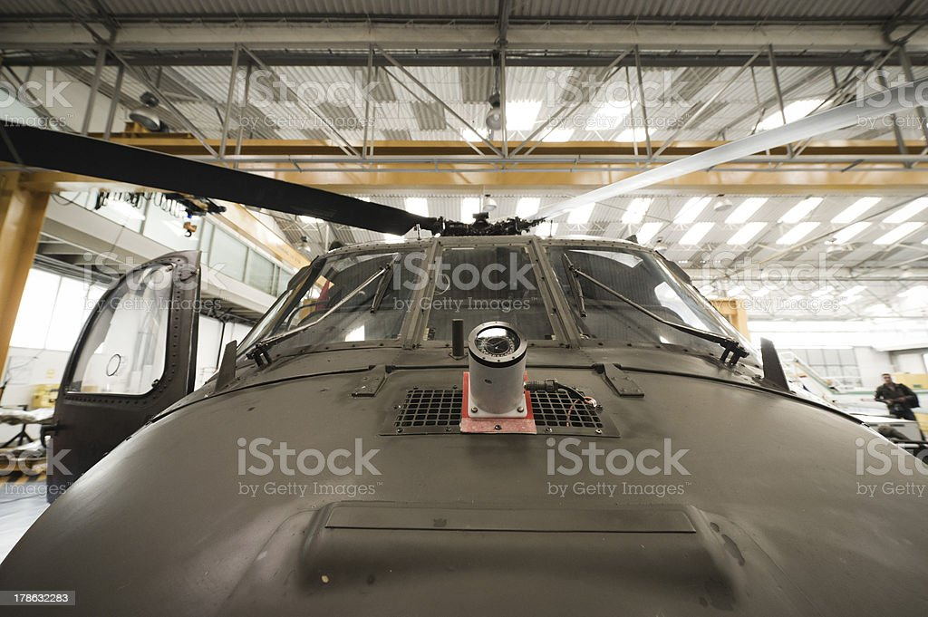 Black Hawk helicopter in hangar royalty-free stock photo