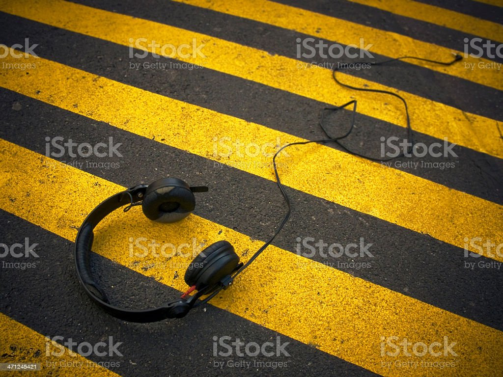 Black headphones laying on the ground stock photo