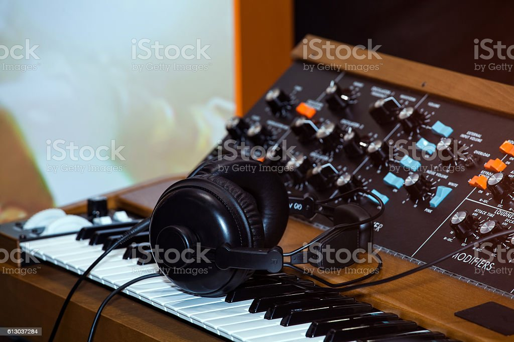 Black headphones on the keyboard piano stock photo