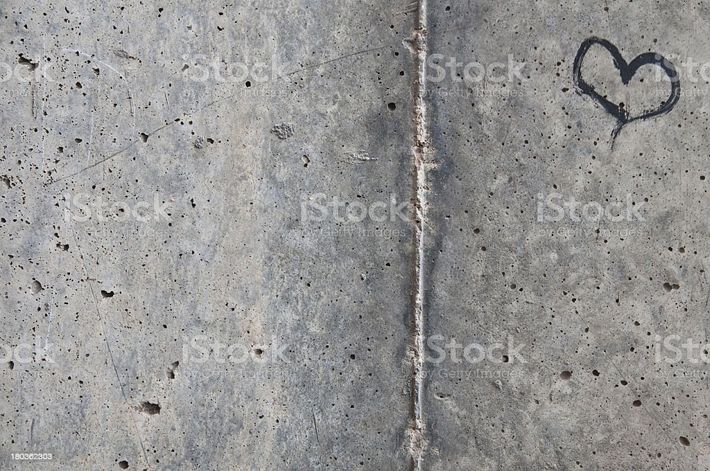 Black Heart on Concrete Background stock photo