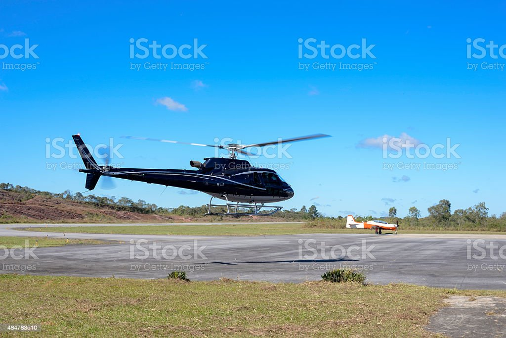 Black Helicopter at the Airport stock photo