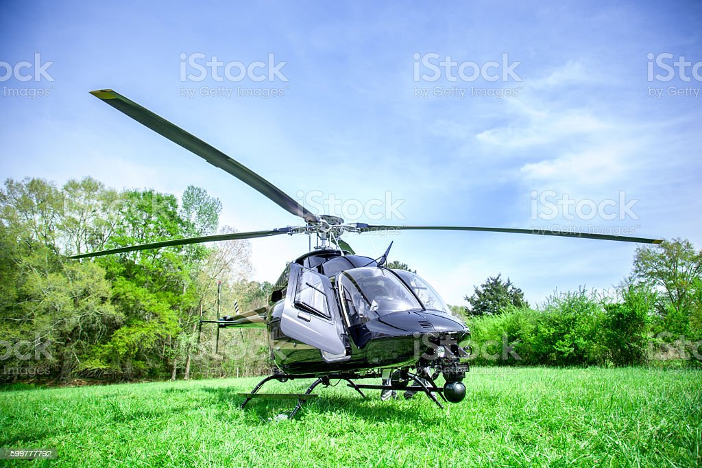 Black helicopter getting ready to fly. stock photo