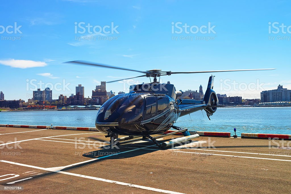 Black Helicopter on helipad in Lower Manhattan in New York stock photo