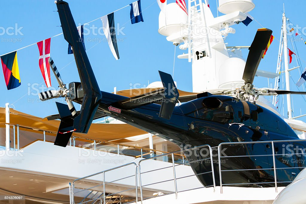 Black Helicopter on the yacht stock photo