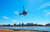 Black Helicopter taking off from helipad in Lower Manhattan