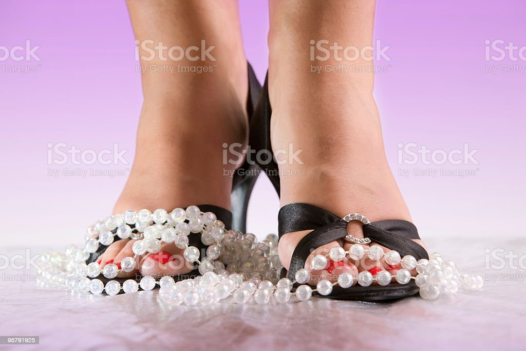 Black High heel shoes and pearls stock photo