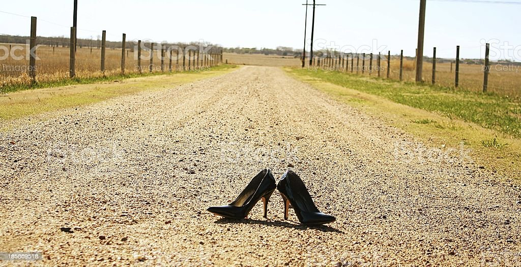 Black High Heels on Dirt Road royalty-free stock photo