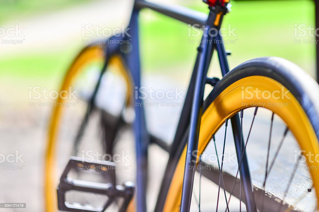 Black Hipster Fixed Gear Bike with Gold Rims stock photo