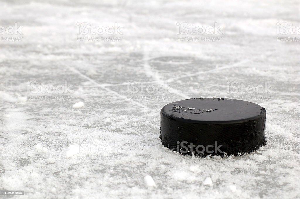 black hockey puck stock photo