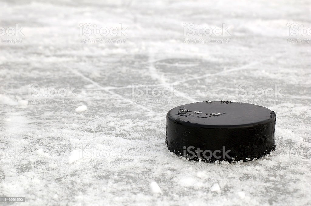 black hockey puck stock photo