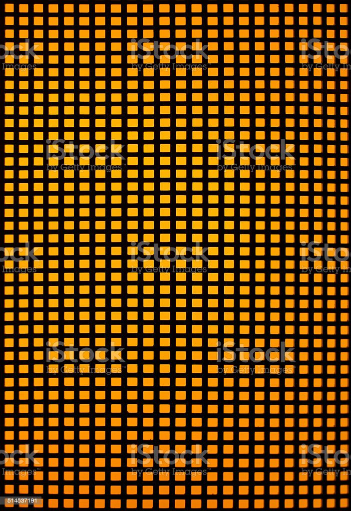 Black hole grid with yellow backlight royalty-free stock photo