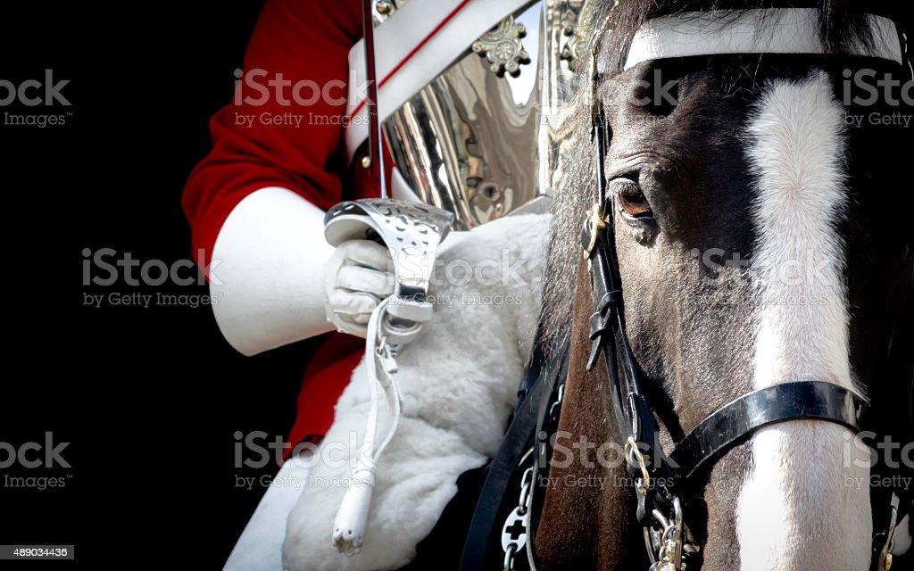 Black horse mounted by a british royal guard stock photo