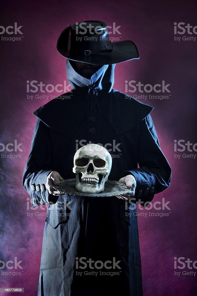 Black Horseman on red holding skull with platter smoke occult stock photo