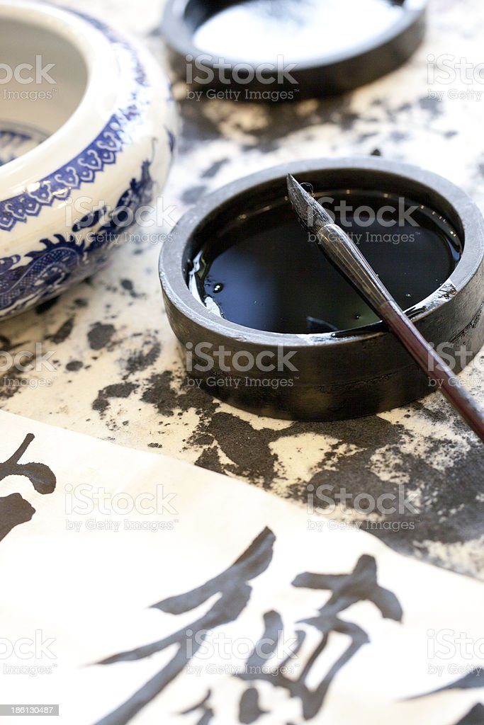 Black ink and brush pen with traditional Chinese characters stock photo