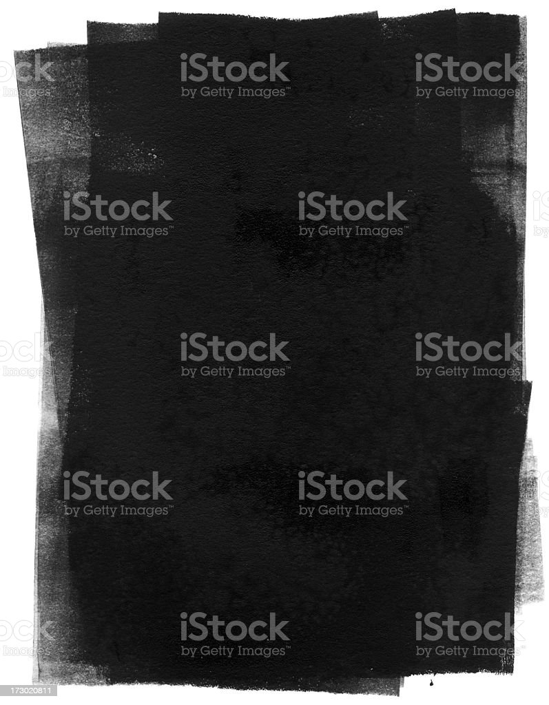 Black ink rolled out onto a white background stock photo