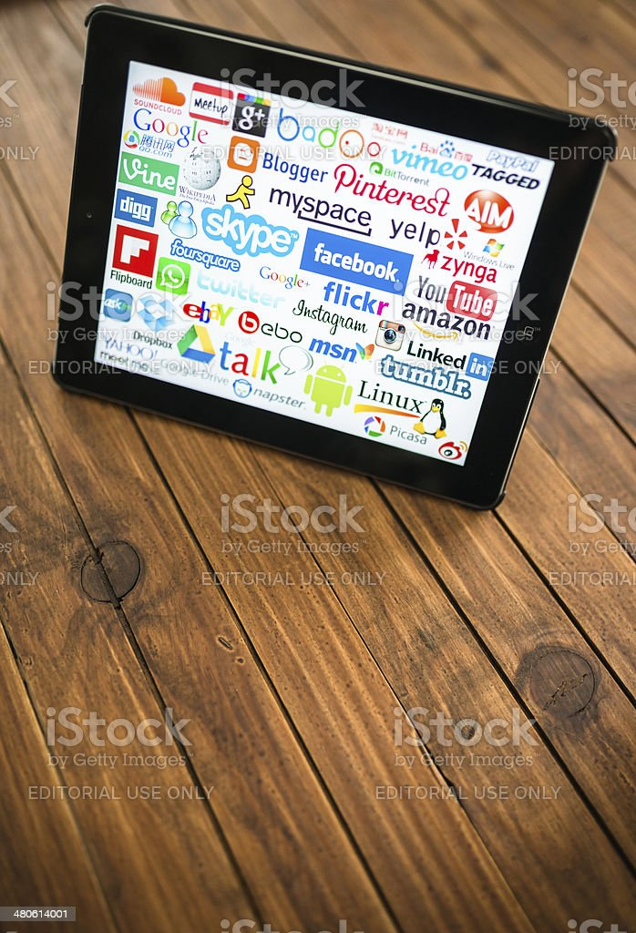 black Ipad showing the most famous website stock photo