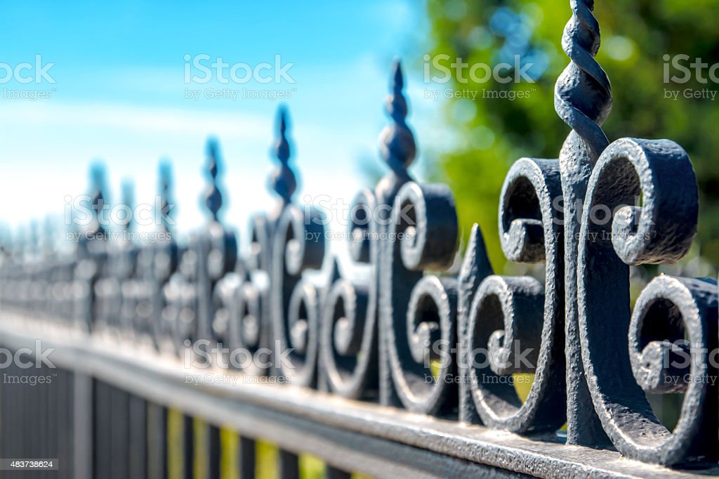 Black iron fence volute outdoor perspective in selective focus stock photo