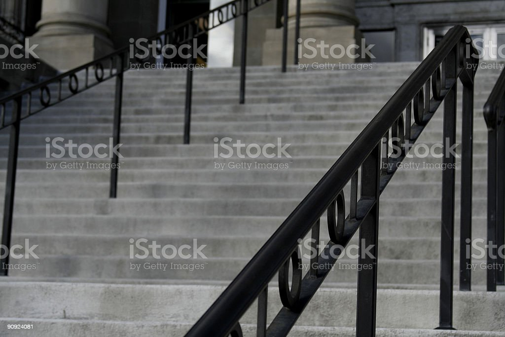 Black Iron Railing on Wide Steps stock photo