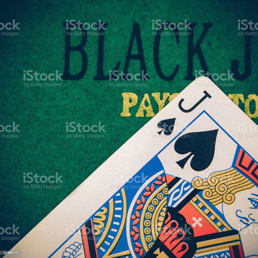 black jack with red poker chips in the background. stock photo