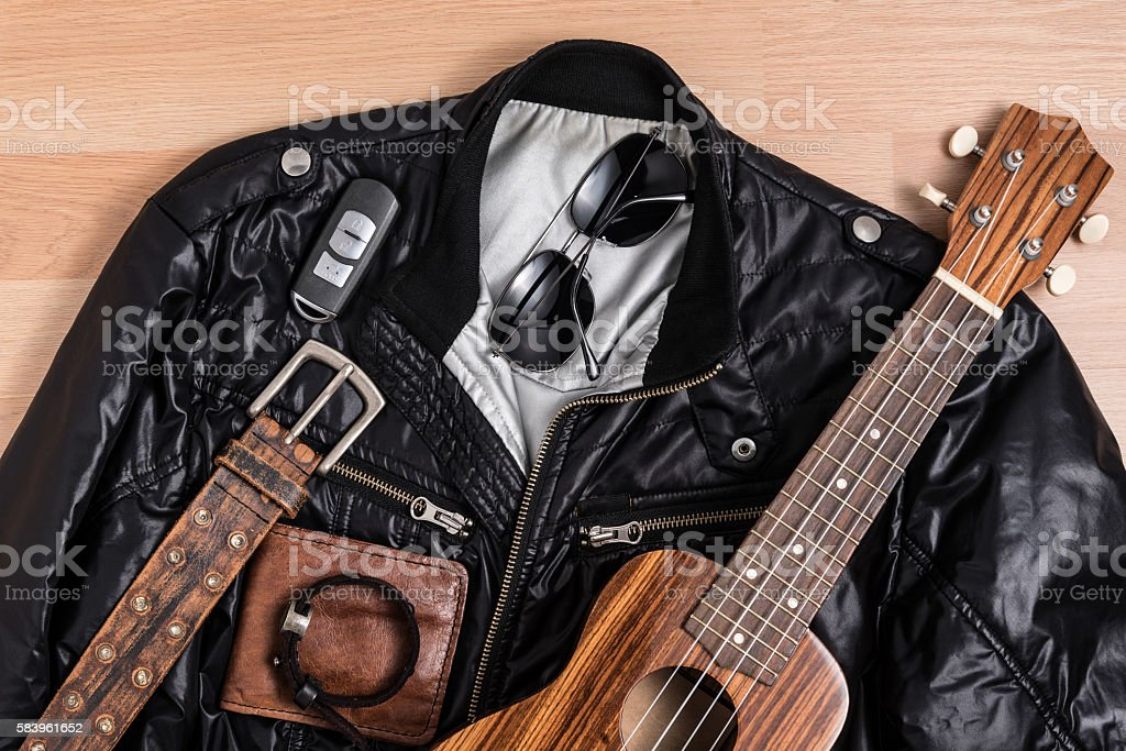 Black jacket with men accessories and ukulele stock photo